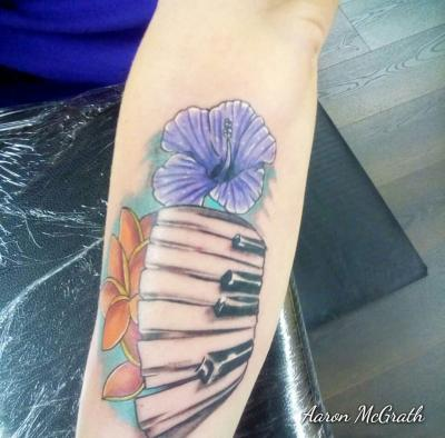 Aaron McGrath Piano and flower tattoo