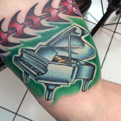 Grand Piano Tattoo by Kendal Harkey
