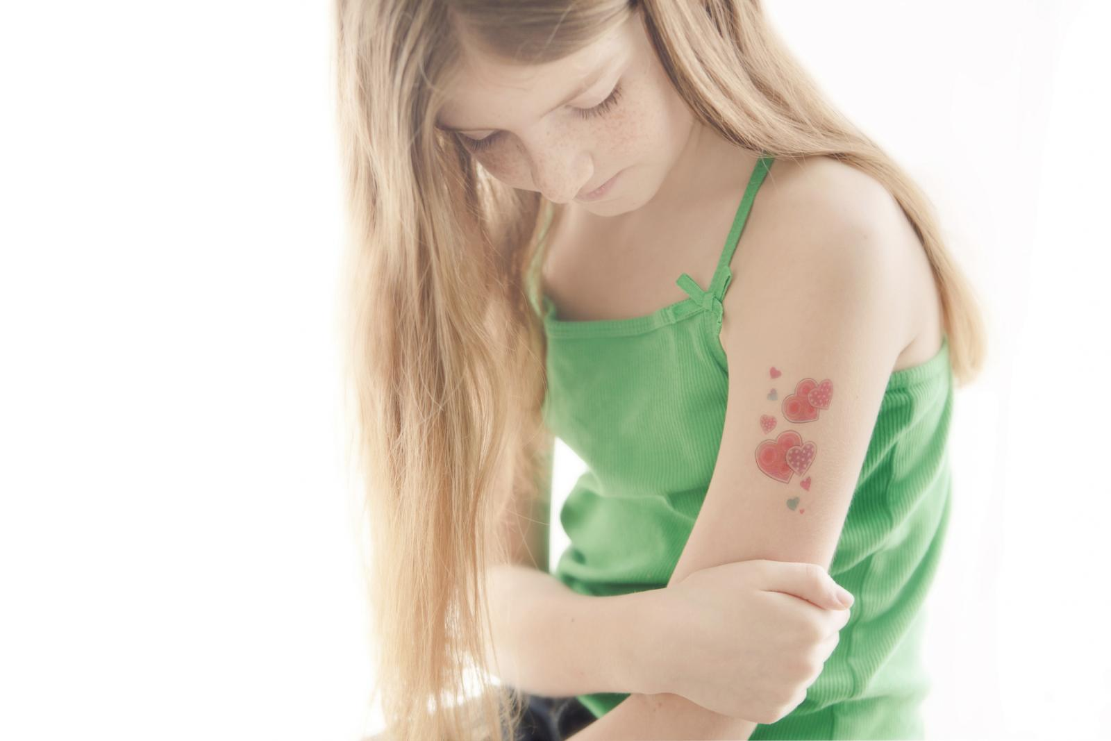 Girl with temporary tattoo on her arm
