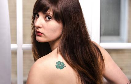 Young woman with shamrock tattoo