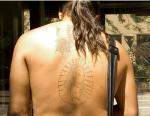 Tattoo of Jesus on a man's back