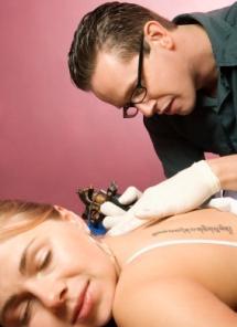 tattoo artist and woman