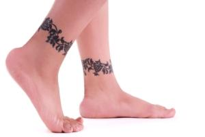 Vine tattoos on both ankles