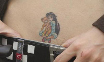 Girl_with_teddy.jpg