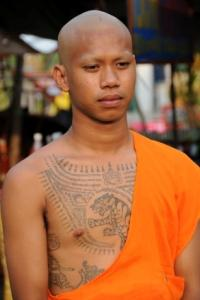 Young monk with tattoos