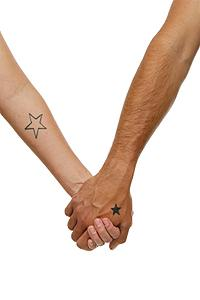 Two simplistic star tattoos