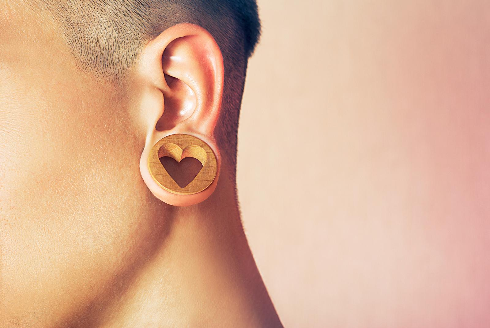 Man with ear tunnel