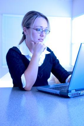 Woman pondering at computer