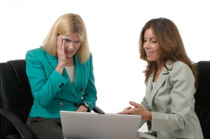 Two women looking at computer