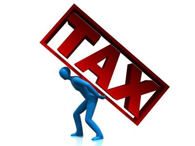 Man holding tax word