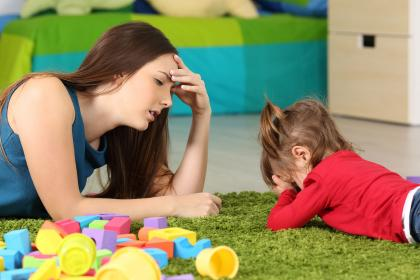 Babysitter with crying child