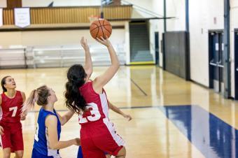 High school female basketball team playing a game