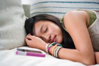 Teenage girl sleeping on sofa