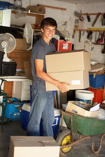 Teenage Boy Moving Boxes