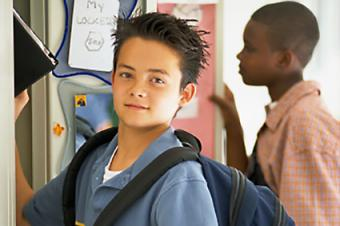 Middle school boy at locker