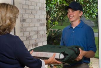 Teen boy delivering pizza