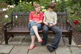 Girl and boy with cell phone