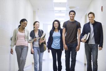 High school students walking down school corridor