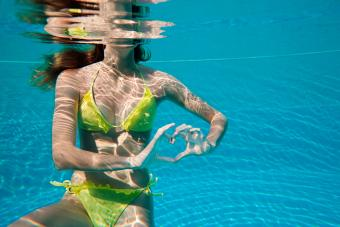 Girl in ruffled bikini in pool