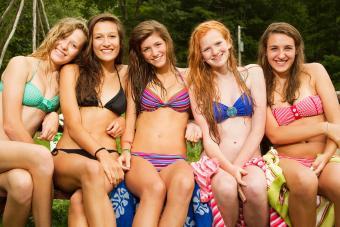 five teen girls wearing trendy bikinis
