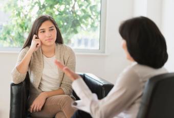 Teenage girl talking to therapist