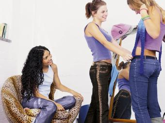 Teenage girls trying on clothes