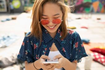 Girl with sunglasses texting question