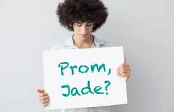 Young man asking a girl to prom