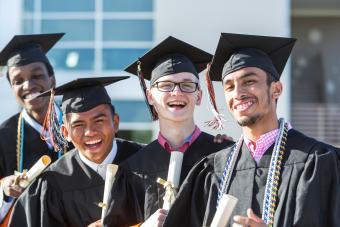four friends graduating