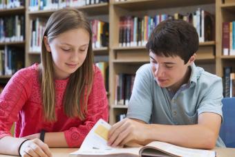 guy and girl doing homework together