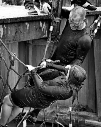 Climbing a net during obstacle run