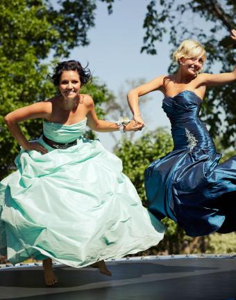 jumping on trampoline in prom dresses