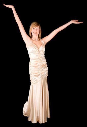 https://cf.ltkcdn.net/teens/images/slide/243175-582x850-gold-satin-prom-dress.jpg