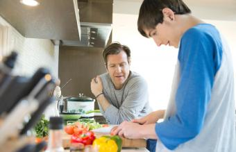 Father teaching son to cook