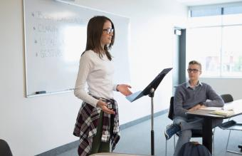 Girl student speaking in classroom