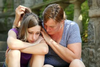 Woman hugging teen girl