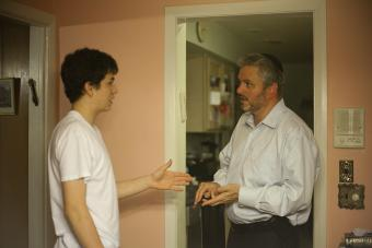 Father and teen son arguing