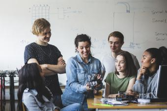 Teens working with a robotics project