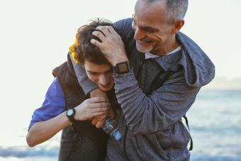 happy father and teen son