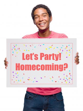 Boy holding Homecoming sign question