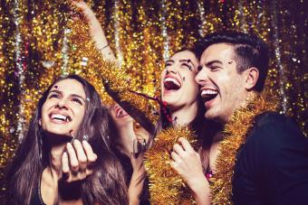 Happy people enjoing the party with confetti