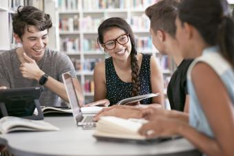 Group of students working in group & laughing