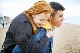 Young couple enjoying moment together at the beach in winter