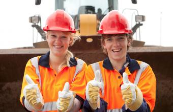 Teenage road construction trainees