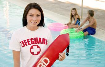 Teen working summer job as a lifeguard