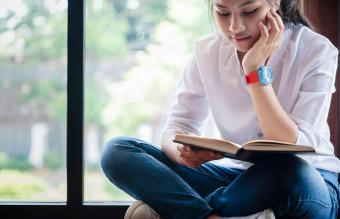 Teenage Girl Reading Book