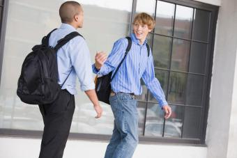 two teen boys carrying backpacks