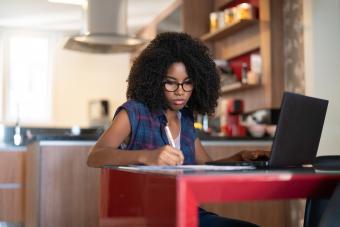 Teen girl working online