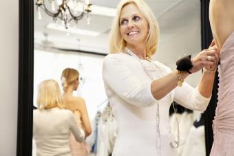 Seamstress making prom dress alterations