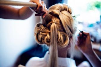 Hairdresser and beautician testing beauty styles